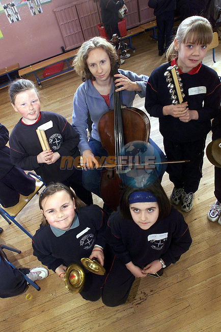 """Hannah Finlay, Scarlet Crescent, Laura Sheils, Glenmore Drive, Nicole Keeley, Scarlet Street and Nicole Kierans, Moneymore pupils from St. Brigid's N.S. who took part in the ESB/National Concert Hall """"in Tune"""" Residency pictured with Susan Doyle from the National Concert Hall..Picture Paul Mohan Newsfile"""
