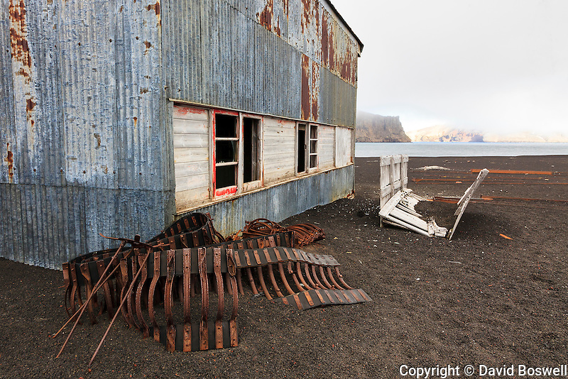 A decrepit British hanger at Whalers Bay on Deception Island, in the South Shetland Islands near the Antarctic Peninsula.  Whalers Bay is the site of a Norwegian whaling base operating from 1911-1931 when it was abandoned due to the decline of the whaling industry.  In 1944 the British used the building for a base they operated here until 1969 when they too abandoned the base, this time due to volcanic activity.