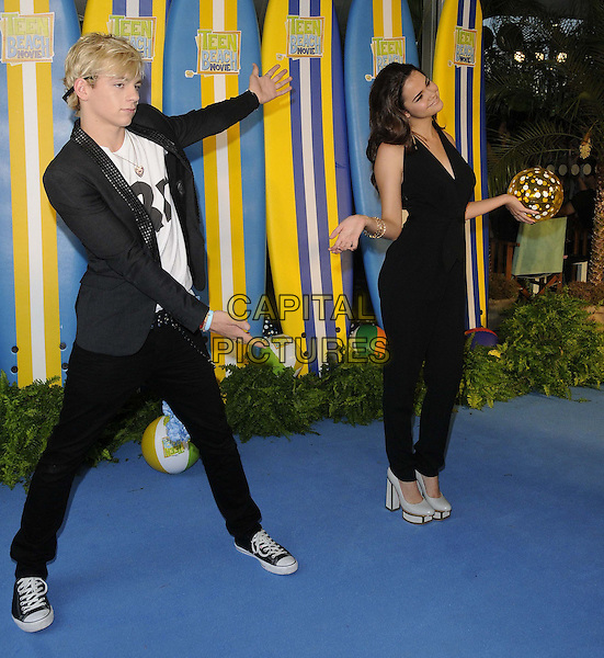 Ross Lynch &amp; Maia Mitchell<br /> The &quot;Teen Beach Movie&quot; VIP film screening, The Riverfront Cafe Bar, BFI, London, England.<br /> July 7th, 2013<br /> full length black jumpsuit  jacket jeans denim white platform shoes top hands arms ball posing <br /> CAP/CAN<br /> &copy;Can Nguyen/Capital Pictures