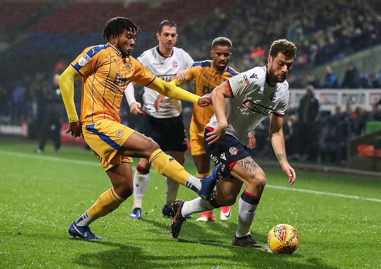 Bolton Wanderers' Yanic Wildschut competing with Wigan Athletic's Reece James<br /> <br /> Photographer Andrew Kearns/CameraSport<br /> <br /> The EFL Sky Bet Championship - Bolton Wanderers v Wigan Athletic - Saturday 1st December 2018 - University of Bolton Stadium - Bolton<br /> <br /> World Copyright © 2018 CameraSport. All rights reserved. 43 Linden Ave. Countesthorpe. Leicester. England. LE8 5PG - Tel: +44 (0) 116 277 4147 - admin@camerasport.com - www.camerasport.com