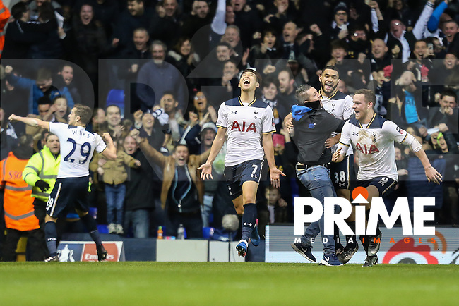 Heung-Min Son of Tottenham Hotspur (centre) celebrates after he scores his team's fourth goal of the game to make the score 4-3 during the FA Cup 4th round match between Tottenham Hotspur and Wycombe Wanderers at White Hart Lane, London, England on 28 January 2017. Photo by PRiME Media Images / David Horn.
