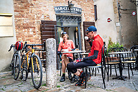 Cyclists at an Italian bar for coffee in Pienza, Italy