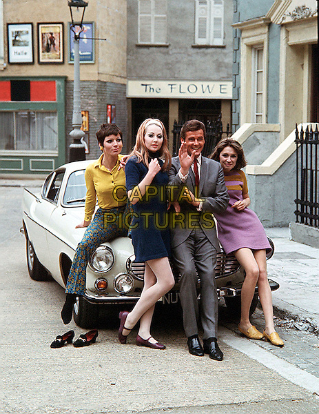 "ROGER MOORE WITH ""LES GIRLS'"".in The Saint.*Editorial Use Only*.www.capitalpictures.com.sales@capitalpictures.com.Supplied by Capital Pictures."