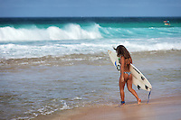 Tan Brunette Female Surfer