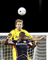 Columbus Crew defender Chad Marshall (14) and New England Revolution forward Dimitry Imbongo (92) battle for head ball. In a Major League Soccer (MLS) match, the New England Revolution defeated Columbus Crew, 2-0, at Gillette Stadium on September 5, 2012.