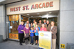 Drogheda Senior Citizens' Sunflower growing competition; the committee standing proudly outside. West St. Arcade, where they are located..Picture: Shane Maguire / www.newsfile.ie