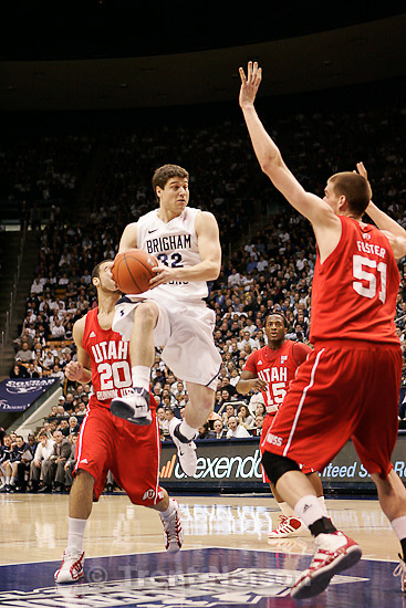Trent Nelson  |  The Salt Lake Tribune.BYU's Jimmer Fredette looks for the shot with Utah's J.J. O'Brien (20) and Utah's David Foster defending in the first half at BYU vs. Utah, college basketball in Provo, Utah, Saturday, February 12, 2011.