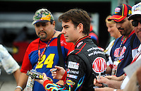 Nov. 20, 2009; Homestead, FL, USA; NASCAR Sprint Cup Series driver Jeff Gordon signs autographs for fans during practice for the Ford 400 at Homestead Miami Speedway. Mandatory Credit: Mark J. Rebilas-