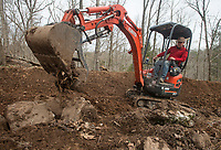 NWA Democrat-Gazette/BEN GOFF @NWABENGOFF<br /> Bret Deutscher with Rock Solid Trail Contracting uses an excavator to build a new section of trail Wednesday, April 11, 2018, at Lake Leatherwood Park in Eureka Springs. The park is adding six new downhill lines.