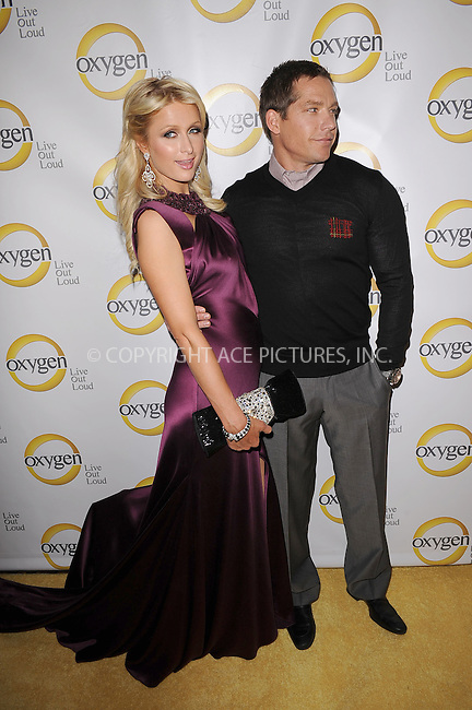 WWW.ACEPIXS.COM . . . . . .April 4, 2011...New York City...Paris Hilton and Cy Waits attend the Oxygen Upfront Presentation on April 4, 2011 in New York City....Please byline: KRISTIN CALLAHAN - ACEPIXS.COM.. . . . . . ..Ace Pictures, Inc: ..tel: (212) 243 8787 or (646) 769 0430..e-mail: info@acepixs.com..web: http://www.acepixs.com .