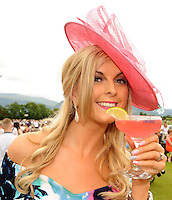 17-07-2014: Denise O'Callaghan, Killarney, enjoying a cocktail at the Ross Hotel Lane Bar Cocktail and Champagne Bar  at Killarney Races ladies day on Thursday.  Picture: Eamonn Keogh (MacMonagle, Killarney)   NO REPRO FREE PR PHOTO