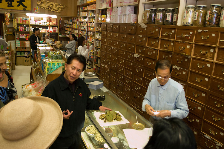 California: Chinatown San Francisco. Celebrity chef Martin Yan leads tour to herb shop. Photo #: chinatown-san-francisco-17-casanf16813. Photo copyright Lee Foster.