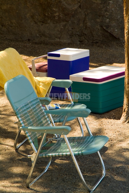 Chairs and coolers at a camping site