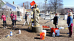 WATERBURY CT. 16 March 2018-031919SV04-Rev. Jim Sullivan pours water over St. Joseph while cleaning the statue with Sacred Heart High students at the St. Joseph Cemetery in Waterbury Tuesday. Tuesday March 19th was St. Joseph Day. <br /> Steven Valenti Republican-American