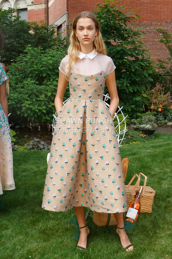 "Model poses in a camel rose garden brocade bustier dress, from the Lela Rose Resort 2018 ""Garden Party"" collection in Jefferson Market Garden on June 7 2017, during Resort Fashion Week in New York City."