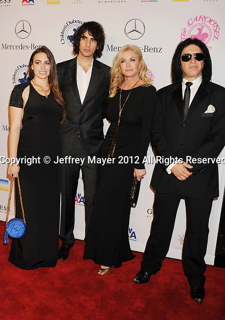 BEVERLY HILLS, CA - OCTOBER 20: Sophie Tweed-Simmons, Nick Simmons, Shannon Tweed and Gene Simmons arrive at the 26th Anniversary Carousel Of Hope Ball presented by Mercedes-Benz at The Beverly Hilton Hotel on October 20, 2012 in Beverly Hills, California.