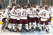 The Eagles gather around their net. - The visiting University of Notre Dame Fighting Irish defeated the Boston College Eagles 7-2 on Friday, March 14, 2014, in the first game of their Hockey East quarterfinals matchup at Kelley Rink in Conte Forum in Chestnut Hill, Massachusetts.