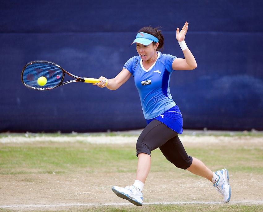 Jie Zheng CHN in action during her victory over Lesia Tsurenko UKR in their Women's Singles 1st Round match - J.Zheng (CHN) def. A.Kudryavtseva (RUS) 6-4 4-6 6-3..International Womens Tennis - 2012 WTA Tour - The AEGON Classic - Edgbaston Priory Club - Birmingham - Day 2 - Tuesday 7th June 2012..