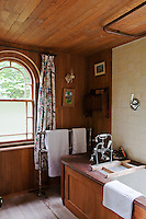 The bathroom may be rudimentary with bare wooden floorboards and wood covered walls but the bath has great views over the tree tops