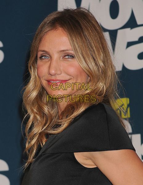 Cameron Diaz.in the Press Room at the 2011 MTV Movie Awards at Universal Studios' Gibson Amphitheatre in Universal City, California, USA, June 5th 2011.  .pressroom portrait headshot black smiling  side .CAP/ROT/TM.©TM/Roth Stock/Capital Pictures