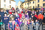 SURROUNDED: Hundreds of children with their parents who surrounded Santa on his arrival in the Square Tralee on Saturday............................ ..........