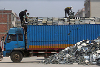 A fresh shipment of old PC computers arrives in Guiyu in China's southern Guangdong Province March 8, 2005. For years, developed countries have been exporting tons of electronic waste to China for inexpensive, labor-intensive recycling and disposal. Since 2000, it's been illegal to import electronic waste into China for this kind of environmentally unsound recycling. But tons of debris are smuggled in with legitimate imports, corruption is common among local officials, and China's appetite for scrap is so enormous that the shipments just keep on coming...