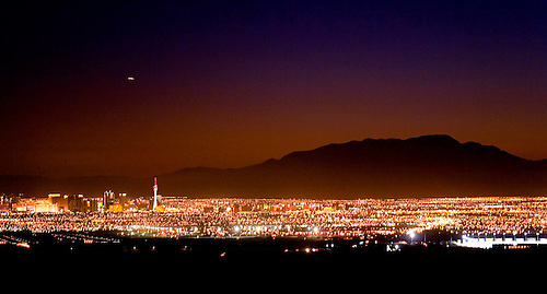 THE LIGHTS OF LAS VEGAS GLOW IN EARLY EVENING