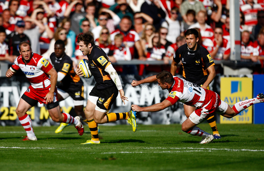 Photo: Richard Lane/Richard Lane Photography. Gloucester Rugby v London Wasps. Aviva Premiership. 22/09/2012. Wasps' Elliot Daly breaks for a try.
