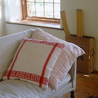 In the informal living room cushion covers have been sewn from red and white linen tea towels