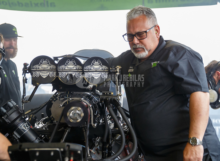 Feb 10, 2017; Pomona, CA, USA; Tommy DeLago , crew chief for NHRA funny car driver Alexis DeJoria during qualifying for the Winternationals at Auto Club Raceway at Pomona. Mandatory Credit: Mark J. Rebilas-USA TODAY Sports