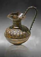 Phrygian bronze trefoil jug with a beated geometric design. From Gordion. Phrygian Collection, 8th century BC - Museum of Anatolian Civilisations Ankara. Turkey. Against a grey background
