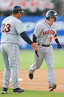 Blake Kelso #5 of the Hagerstown Suns is congratulated by manager Brian Daubach #23 as he rounds third base after hitting a home run against the Kannapolis Intimidators at Fieldcrest Cannon Stadium on May 31, 2011 in Kannapolis, North Carolina.   Photo by Brian Westerholt / Four Seam Images