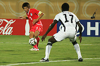 South Korea's Ja Cheol Koo (7) makes a goal attempt against Ghana's  John Benson (17) during the FIFA Under 20 World Cup Quarter-final match between Ghana and South Korea at the Mubarak Stadium  in Suez, Egypt, on October 09, 2009.