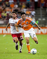 Chicago Fire midfielder Peter Lowry (29) holds Houston Dynamo forward Brian Ching (25).  Houston Dynamo defeated Chicago Fire 3-2  at Robertson Stadium in Houston, TX on August 9, 2009.
