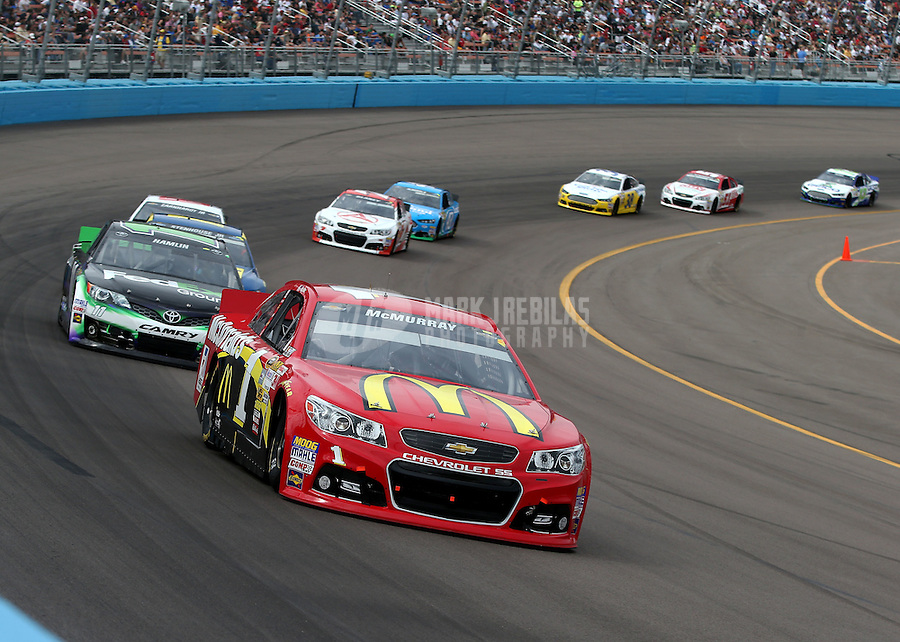 Mar. 3, 2013; Avondale, AZ, USA; NASCAR Sprint Cup Series driver Jamie McMurray leads Denny Hamlin during the Subway Fresh Fit 500 at Phoenix International Raceway. Mandatory Credit: Mark J. Rebilas-
