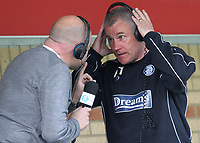 Mark Clemmit from Radio 5 Live, gets ready to interview Wycombe Wanderers Manager, Peter Taylor during Wycombe Wanderers vs Notts County, Coca Cola League Division Two Football at Adams Park on 2nd May 2009