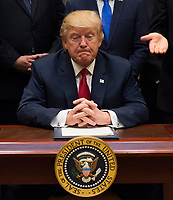 United States President Donald Trump listens after signing the S. 544 the Veterans Choice Program Extension and Improvement Act in the Roosevelt Room at the White House in Washington, DC on April 19, 2017.<br /> CAP/MPI/CNP/RS<br /> &copy;RS/CNP/MPI/Capital Pictures