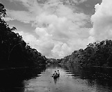 PERU, Amazon Rainforest, South America, Latin America, two people sailing canoe in Yanayacu River