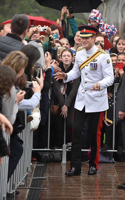 AUSTRALIA, Canberra : Captain Wales braves the rain to shake hands with onlookers after laying a wreath at the Australian War Memorial, Canberra on 6 April 2015. AFP PHOTO / MARK GRAHAM