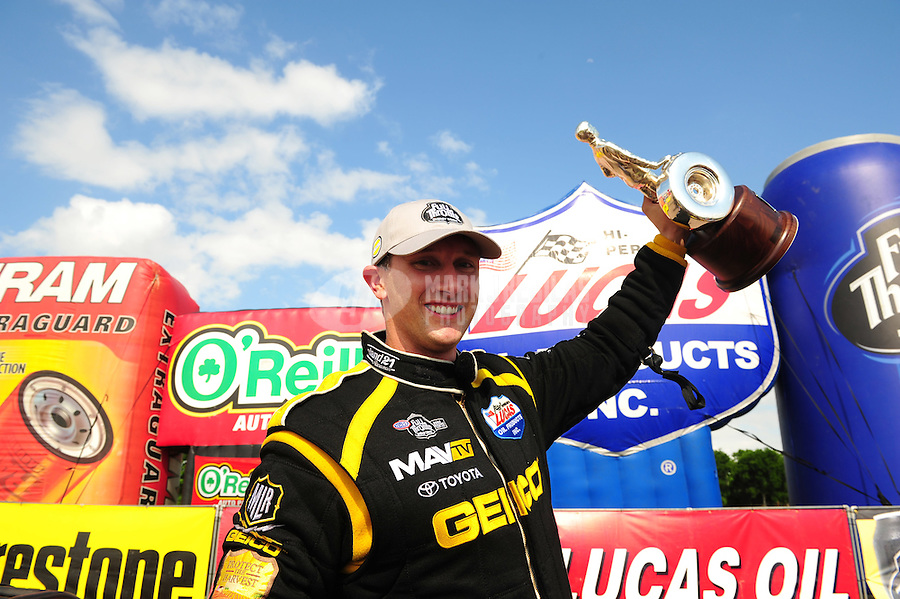 Apr. 29, 2012; Baytown, TX, USA: NHRA top fuel dragster driver Morgan Lucas celebrates after winning the Spring Nationals at Royal Purple Raceway. Mandatory Credit: Mark J. Rebilas-