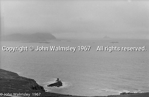 "View towards the Blasket Islands from Dunquin (in Gaelic, Dún Chaoin, meaning ""Caon's stronghold""), on the tip of the Dingle Peninsula, County Kerry, Ireland.  1971."