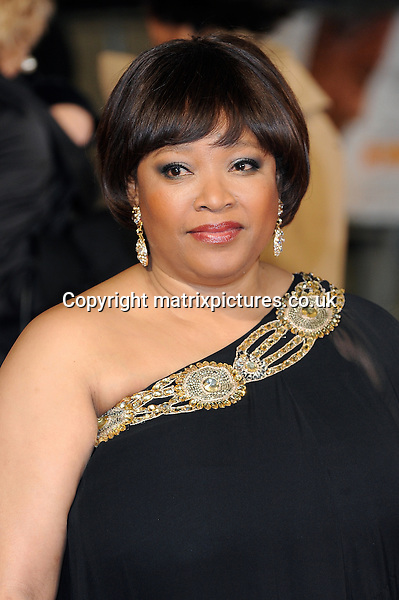 NON EXCLUSIVE PICTURE: PAUL TREADWAY / MATRIXPICTURES.CO.UK<br /> PLEASE CREDIT ALL USES<br /> <br /> WORLD RIGHTS<br /> <br /> Zindzi Mandela, the grand daughter of late former South African President Nelson Mandela, attends the Royal film performance of &quot;Mandela: Long Walk to Freedom&quot; at the Odeon Theatre at Leicester Square in London, England.<br /> <br /> DECEMBER 5th 2013<br /> <br /> REF: PTY 137771