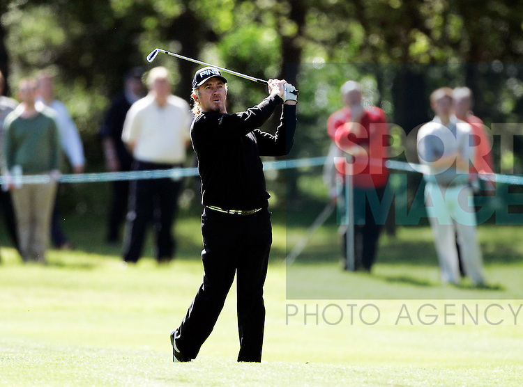 Miguel Angel Jimenez of Spain plays a shot