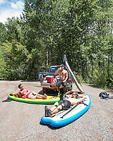Paddle borders enjoy a beer near the San Miguel River Colorado, Monday, July 6, 2015. <br /> <br /> Photo by Matt Nager