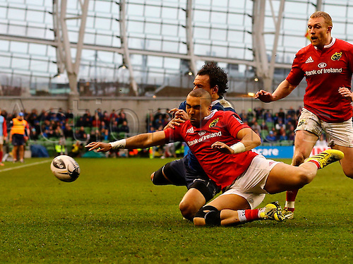 02.04.2016. Aviva Stadium, Dublin, Ireland. Guinness Pro12.  Leinster versus Munster. <br /> Simon Zebo (Munster) gets to the ball ahead of Isa Nacewa (Captain Leinster)  to put the ball in touch.