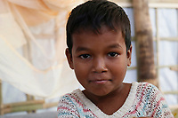 Four-year-old Sofone, pictured at a Diphtheria Treatment Centre in the Kutupalong refugee camp near Cox's Bazar in Bangladesh. Sofone was brought to the centre 24 hours earlier by his mum after he had been feeling unwell with a sore throat and fever. Doctors from the UK's Emergency Medical Team diagnosed him as suffering from Diphtheria, and admitted him for treatment with Diphtheria Anti-Toxin. A day later he was feeling much better and smiling again.
