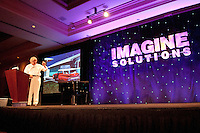 National Geographic Traveler Magazine's Editor in Chief and  Vice President, Keith Bellows, takes center stage at the Imagine Solutions Conference, held at the Ritz Carlton Golf Resort, Naples, Florida, USA, March 21, 2011.. Photo by Debi Pittman Wilkey.