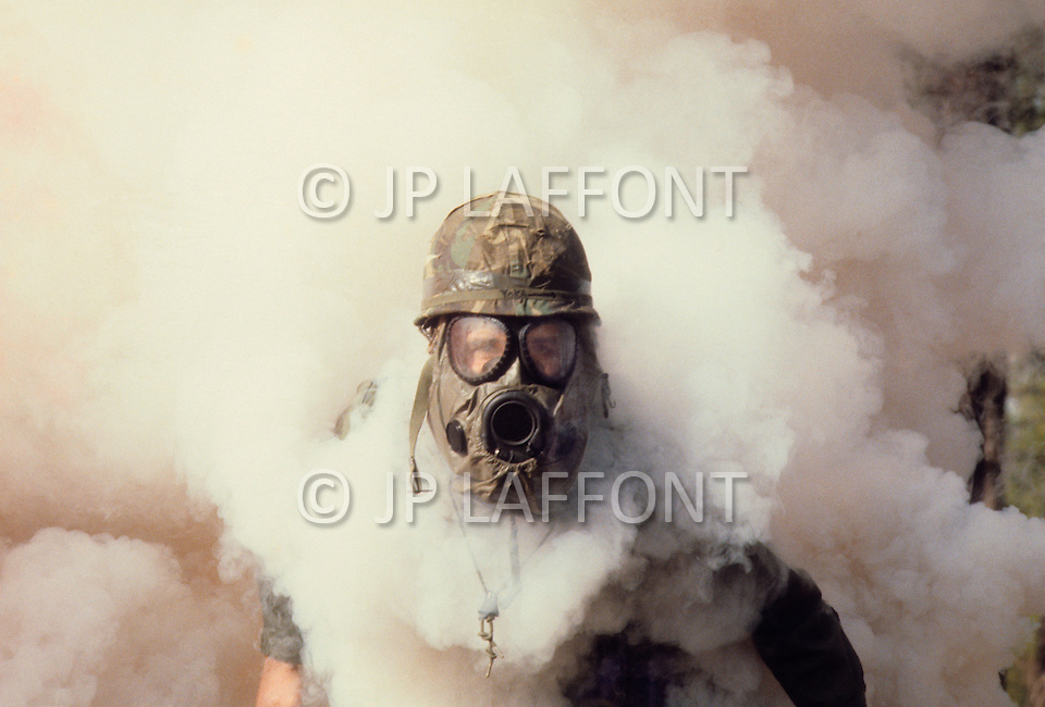 Fort Bragg, North Carolina - January 1980. Photograph taken of members of the 82nd Division carrying out training in chemical warefare at Fort Bragg. The 82nd Airborne Division, founded in 1917, is an active duty airborne division of the United States Army, and specializes in parachute assault operations.