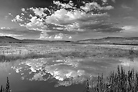 Sunset clouds over pond. Black Rock Desert National Conservation Area. Nevada