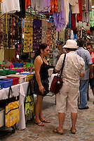 Tourist shopping for Mexican handicrafts in the Mercado Pino Suarez market, Mazatlan, Sinaloa, Mexico